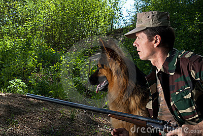 Hunter with dog in rifle. Ambush