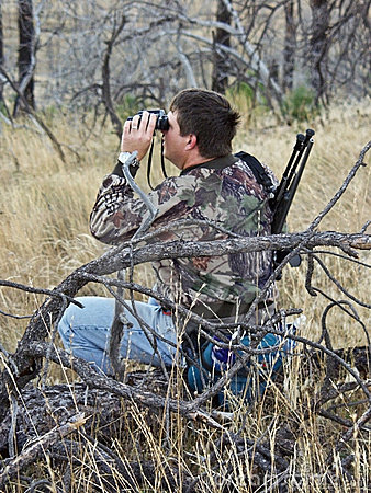 Hunter scouting with binoculars