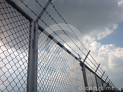 Hurdle or barb wire and white cloud