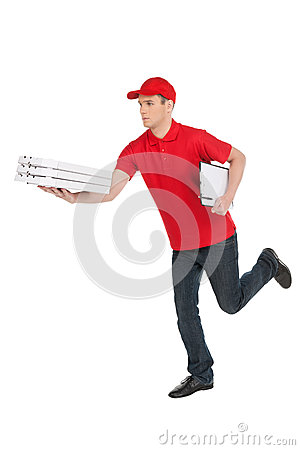 Free Hurrying To Be In Time. Cheerful Young Deliveryman Running With Royalty Free Stock Images - 32586099
