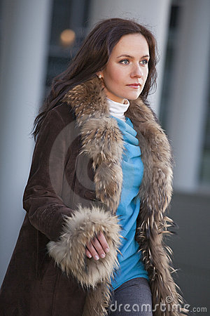 Hurrying woman in fur coat