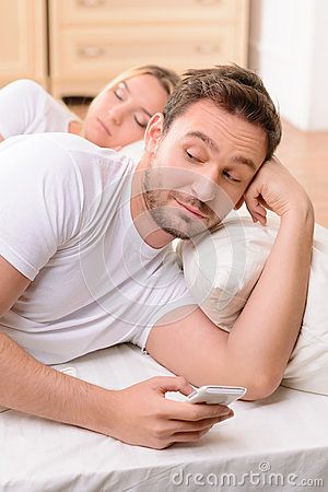 Free Husband And Wife Lying In Bed Stock Photos - 62247833