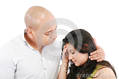 Husband comforts his wife