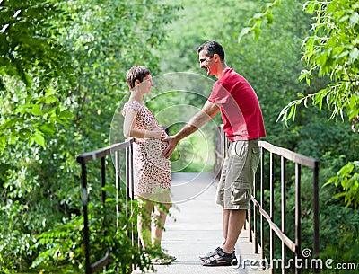 Husband with his wife on the bridge