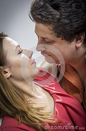 Husband kissing his wife