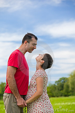 Husband looks at his pregnant wife