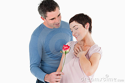 Husband offering a rose to his smiling wife