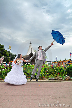 The husband tries to depart on an umbrella