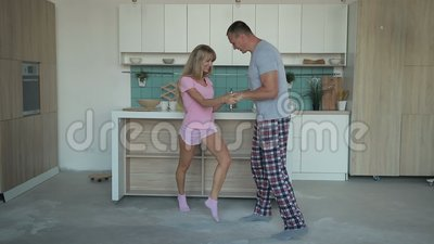 Husband and wife dancing together at home stock video footage
