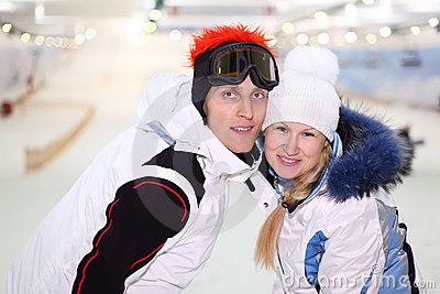 Husband and wife embracing in indoor ski