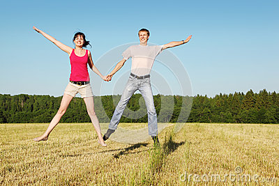 Husband, wife in jump in field