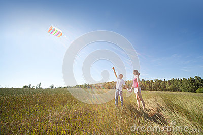 Husband, wife launch kite in field