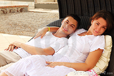Husband and wife sitting on wicker chair