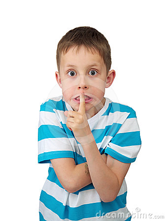 Hush! Tense boy with bulging eyes, finger by lips