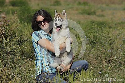Husky puppy with owner