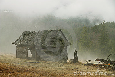 Hut in a foggy morning