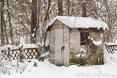 Hut in a garden in winter