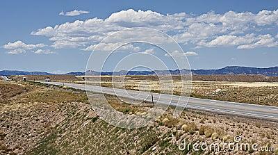 Hwy 191 through a dry Utah towards the horizon