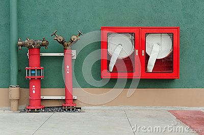 Hydrant with water hoses and fire extinguish