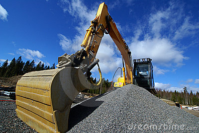 Hydraulic excavator against blue sky