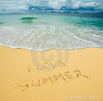 I love summer written in a sandy beach