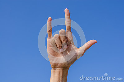 I love you hand sign with blue sky
