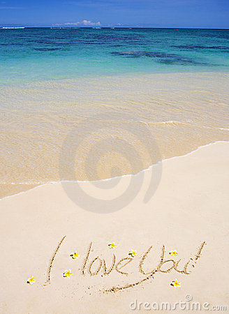 I love you  written on a sandy beach