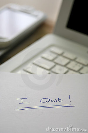 I quit, resignation on desk in an office