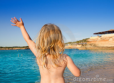 Ibiza Cala Conta little girl greeting hand sign
