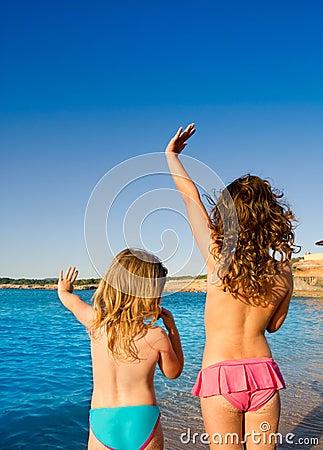 Ibiza Cala Conta little girls greeting hand sign