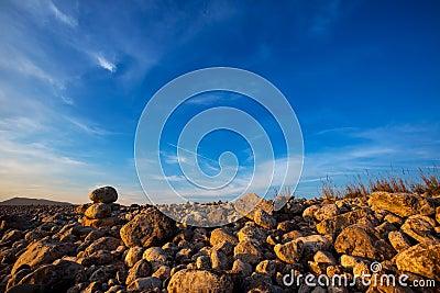 Ibiza Cap des Falco beach rolling stones in San Jose
