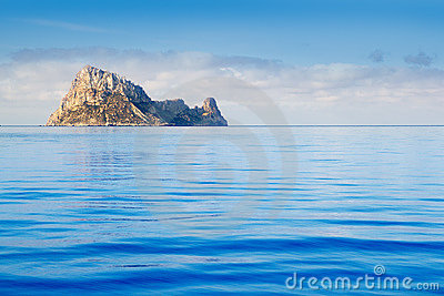 Ibiza Es Vedra island in calm blue water