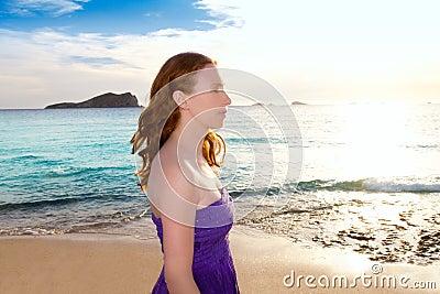 Ibiza girl at sunset in Cala Conta San Antonio
