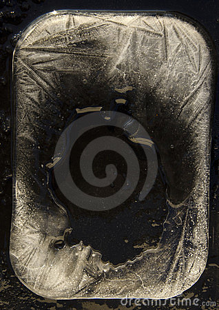 Ice and black plywood background