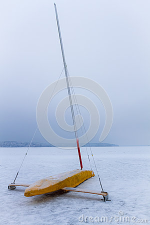Ice boat on frozen lake