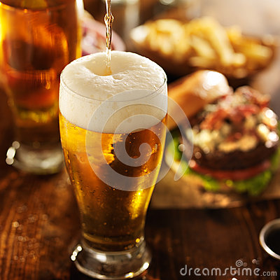 Free Ice Cold Beer Pouring Into Glass Royalty Free Stock Photography - 50316027
