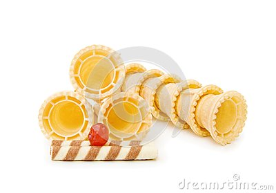 Ice cream cones with cherry and waffle