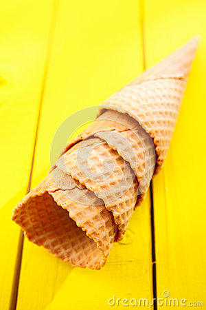 Ice cream cones on yellow table
