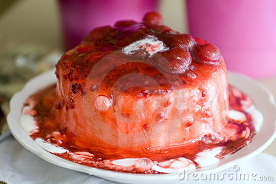 Ice-cream poured with sweet cherry jam