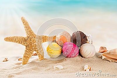 Ice cream scoops on sandy beach
