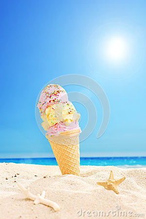 Ice cream stuck in sand on a sunny tropical beach