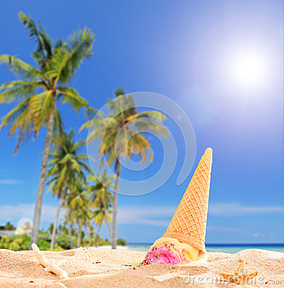 Ice cream thrown in the sand on a tropical beach