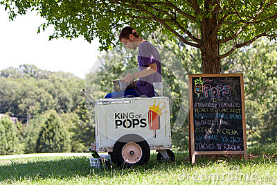 Ice Cream Vendor Waits For Customers In Park Editorial Photography