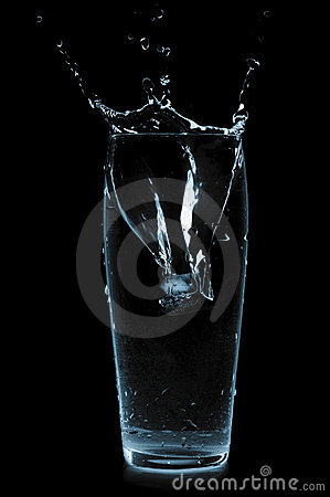 Ice cube in water glass