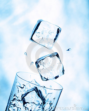 Ice cubes falling into a water glass