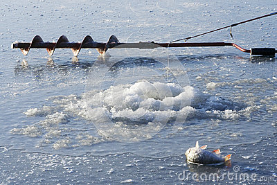 Ice drill and ice fishing rod stock photo image 59689815 for Frozen fishing pole