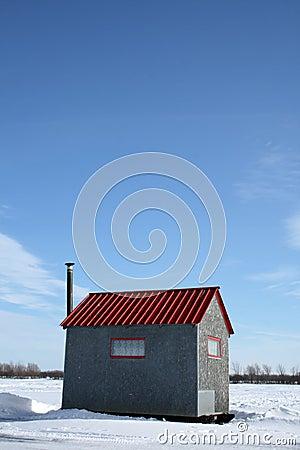 Ice fishing hut under the blue sky