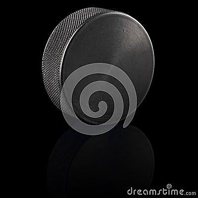 Ice hockey puck black