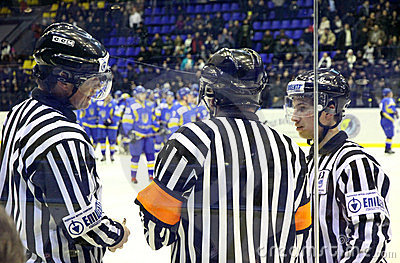 Ice-hockey referees in action Editorial Photo