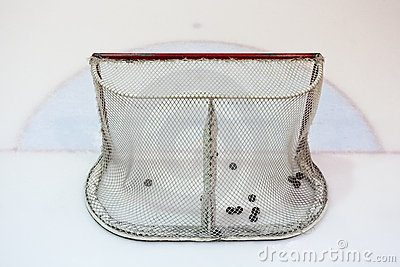 Ice hokey net filled with pucks